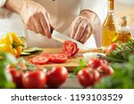 chef slicing fresh tomatoes for ... | Shutterstock . vector #1193103529