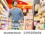 attractive man shopping in a... | Shutterstock . vector #1193105656