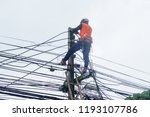 electricity workers are... | Shutterstock . vector #1193107786