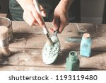 woman paints with a brush ... | Shutterstock . vector #1193119480