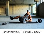 fitness  a young man in the gym | Shutterstock . vector #1193121229