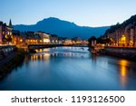 Grenoble at dusk with the river Isere, France.