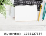 blank white notebook on laptop... | Shutterstock . vector #1193127859