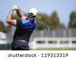 Golfer Hits An Fairway Shot...