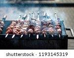 shish kebab on skewers is fried ...   Shutterstock . vector #1193145319
