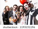 group of happy friends dressed... | Shutterstock . vector #1193151196