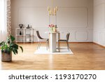 real photo of a spacious dining ...   Shutterstock . vector #1193170270