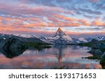 Morning shot of the golden Matterhorn (Monte Cervino, Mont Cervin) pyramid and blue Stellisee lake. Sunrise view of majestic mountain landscape. Valais Alps, Zermatt, Switzerland, Europe. - stock photo