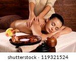 masseur doing massage on woman... | Shutterstock . vector #119321524