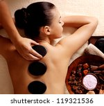 young woman getting hot stone... | Shutterstock . vector #119321536