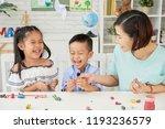 laughing children and teacher... | Shutterstock . vector #1193236579