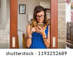 young woman using smart phone... | Shutterstock . vector #1193252689