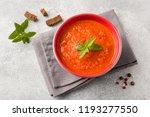 tomato soup in a ceramic bowl... | Shutterstock . vector #1193277550