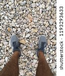 legs and gray trainers on a... | Shutterstock . vector #1193293633