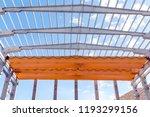 an overhead crane   traveling...   Shutterstock . vector #1193299156
