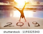 young man handstand on the... | Shutterstock . vector #1193325343
