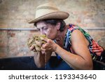 old woman drink grapes must... | Shutterstock . vector #1193343640