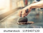 hand of man take cooking of... | Shutterstock . vector #1193407120