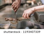 hand of man take cooking of... | Shutterstock . vector #1193407339