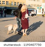 women walking with a dog down... | Shutterstock . vector #1193407750