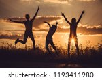 silhouette of three happy... | Shutterstock . vector #1193411980