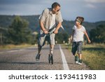 father and son playing on the... | Shutterstock . vector #1193411983