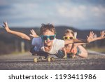 brother and sister playing on... | Shutterstock . vector #1193411986