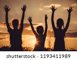 silhouette of three happy... | Shutterstock . vector #1193411989