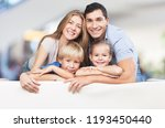beautiful smiling family in... | Shutterstock . vector #1193450440