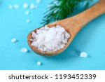 coarse salt crystals on a blue... | Shutterstock . vector #1193452339