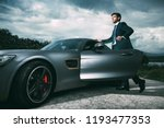 business man in luxury car | Shutterstock . vector #1193477353