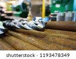 the drills lie on a rack near... | Shutterstock . vector #1193478349