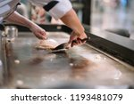 hand of man take cooking of... | Shutterstock . vector #1193481079