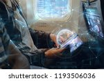 a woman on plane uses the phone ...   Shutterstock . vector #1193506036
