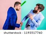 businessman raise bat while... | Shutterstock . vector #1193517760