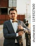 man in gray suit posing | Shutterstock . vector #1193527600