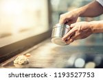 hand of man take cooking of... | Shutterstock . vector #1193527753