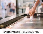 hand of man take cooking of... | Shutterstock . vector #1193527789