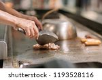 hand of man take cooking of... | Shutterstock . vector #1193528116