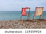 Deck Chairs On A Beach