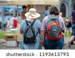 two women with backpacks go... | Shutterstock . vector #1193613793