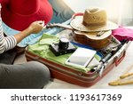 woman hand packing a luggage... | Shutterstock . vector #1193617369