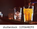 poured alcohol on the bar | Shutterstock . vector #1193648293