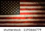 closeup of grunge american flag   Shutterstock . vector #1193666779