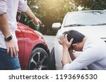 Small photo of Two drivers man arguing after a car traffic accident collision, Traffic Accident and insurance concept.