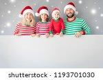 family holding cardboard banner ... | Shutterstock . vector #1193701030