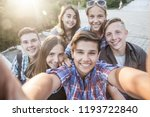 group of teenagers in the park... | Shutterstock . vector #1193722840