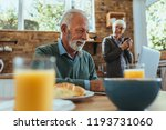 mature couple reading some news ... | Shutterstock . vector #1193731060