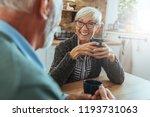 mature couple drinking coffee... | Shutterstock . vector #1193731063