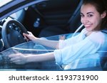 attractive smiling woman driver ... | Shutterstock . vector #1193731900